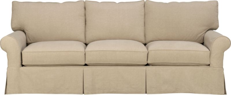 "Machine-washable skirted slipcover tailored for the Cortland Sofa takes on everyday living.<br /><br />Additional <a href=""http://crateandbarrel.custhelp.com/cgi-bin/crateandbarrel.cfg/php/enduser/crate_answer.php?popup=-1&p_faqid=125&p_sid=DMUxFvPi"">slipcovers</a> available below and through stores featuring our Furniture Collection.<br /><br />After you place your order, we will send a fabric swatch via next day air for your final approval. We will contact you to verify both your receipt and approval of the fabric swatch before finalizing your order.<br /><br /><NEWTAG/><ul><li>100% prewashed cotton slipcover</li><li>Machine washable</li></ul>"