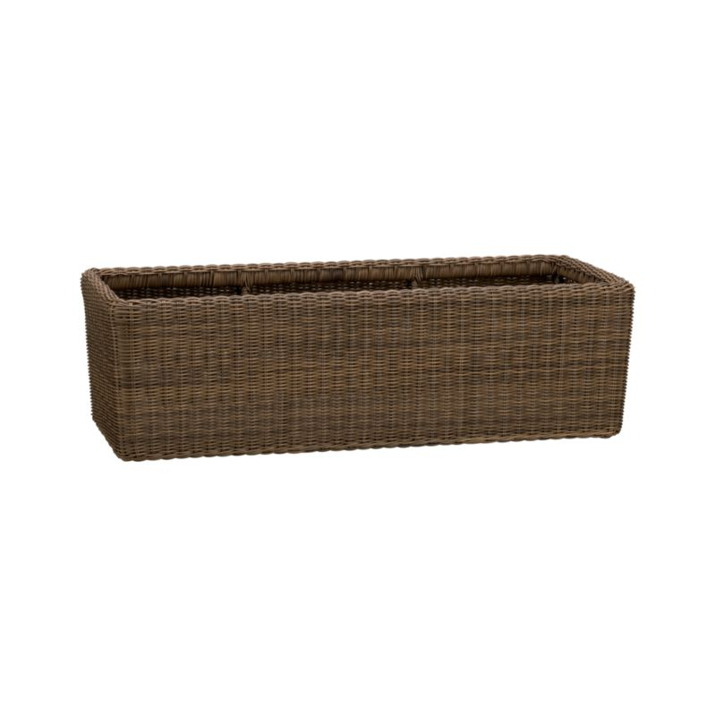 "Woven window-box style planter is crafted of durable, weather-resistant faux rattan with realistic color variation and reinforced rim. A breeze to care for, basket will not erode or deteriorate from moisture exposure.<br /><br /><NEWTAG/><ul><li>Iron and synthetic rattan</li><li>Holds three 8"" pots</li><li>Always use a liner or plastic container</li><li>Bring indoors during freezing months</li><li>Made in Indonesia</li></ul>"