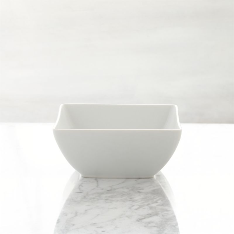 Clean, crisp white porcelain dinnerware combines squares and curves in a dynamic contemporary design.<br /><br /><NEWTAG/><ul><li>Porcelain</li><li>Chip- and stain-resistant</li><li>Dishwasher-, microwave- and oven-safe to 350 degrees</li><li>Made in China</li></ul><br /><br /><br /><br /><br />