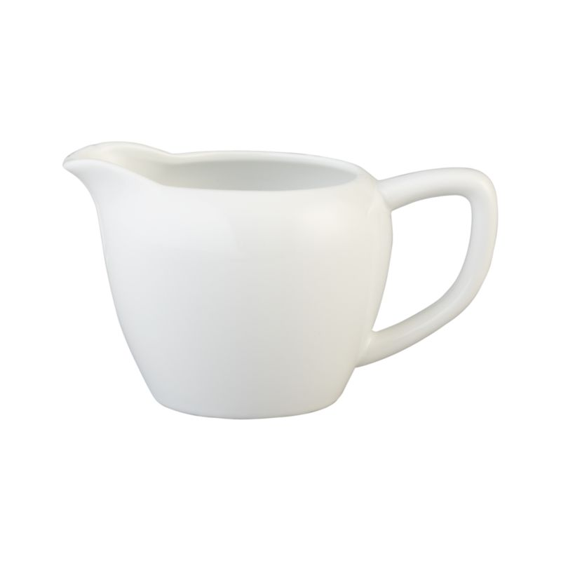 All-purpose creamer with simple lines in durable white porcelain coordinates with most table settings.<br /><br /><NEWTAG/><ul><li>Porcelain</li><li>Dishwasher-, microwave- and freezer-safe</li><li>Made in China</li></ul>