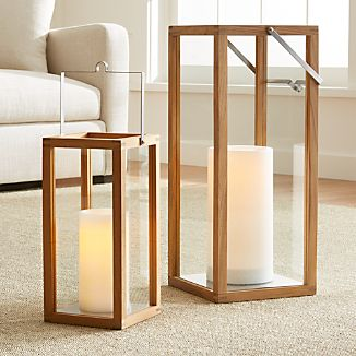 "Clean-lined lanterns cast a warm glow in the home or on the patio framed in unfinished teak and topped with a notched square stainless steel handle.Unfinished teakStainless steel handleIndoor or outdoor useLarge accommodates up to 4""-diameter pillar candle, sold separatelySmall accommodates up to 3""-diameter pillar candle, sold separatelyMade in Indonesia"
