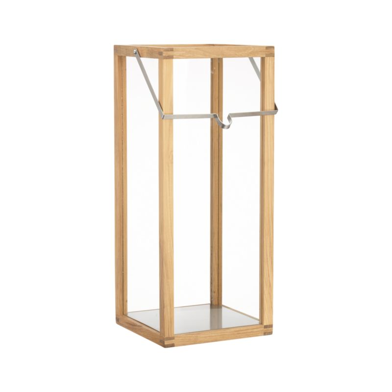 "Clean-lined lantern casts a warm glow in the home or on the patio framed in unfinished teak and topped with a notched square stainless steel handle.<br /><br /><NEWTAG/><ul><li>Unfinished teak</li><li>Stainless steel handle</li><li>Indoor or outdoor use</li><li>Large accommodates up to 4""-diameter pillar candle, sold separately</li><li>Made in Indonesia</li></ul>"