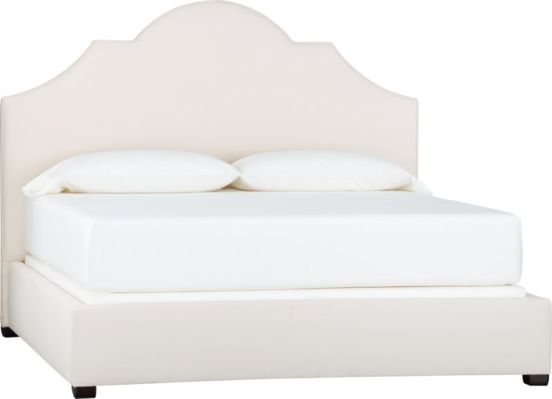 Regal and dramatic, our modern interpretation of the classic crown shape makes an elegant statement in the bedroom. Scaling an impressive five feet high, the sculptural silhouette ascends to a towering arch upholstered in a soft neutral cotton/poly blend fabric and defined with self-welt detail. Mattresses and foundations available (sold separately).<br /><br />After you place your order, we will send a fabric swatch via next day air for your final approval. We will contact you to verify both your receipt and approval of the fabric swatch before finalizing your order.<br /><br /><NEWTAG/><ul><li>Certified sustainable kiln-dried hardwood frame</li><li>Soy-based foam cushioning</li><li>Cotton-poly blend fabric</li><li>Solid maple legs have an espresso finish</li><li>Slat system with support legs</li><li>Accommodates a mattress and foundation</li></ul>