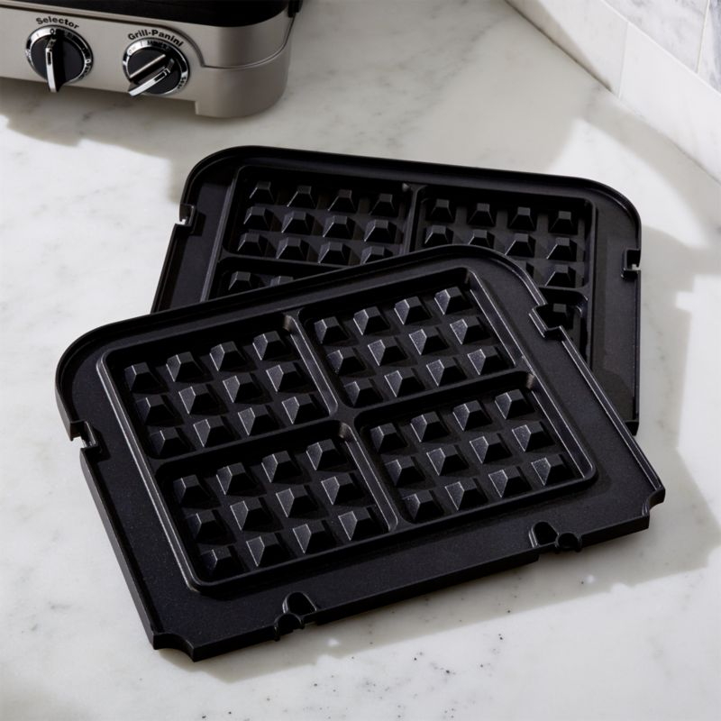 Expand the capabilities of Cuisinart's griddler with the addition of these custom nonstick waffle plates. Dishwasher-safe plates snap into the Cuisinart ® Griddler to make four deep-pocketed Belgian waffles simultaneously.<br /><br /><a href=/shop-by-brand/cuisinart/1> View all Cuisinart products</a><br /><br /><a href=/Gift-Registry/Registrant/Promo-Bonus-Gifts.aspx> Cuisinart and other Wedding Registry offers</a><br /><br /><NEWTAG/><ul><li>Die-cast plates</li><li>Nonstick finish</li><li>Dishwasher-safe</li><li>Plates do not fit the Cuisinart Griddler Deluxe</li><li>Made in China</li></ul>