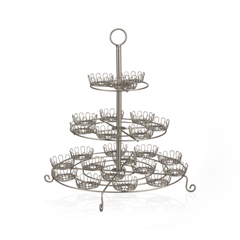 Flower-shaped holders ring classic steel wire stand with scroll feet and convenient loop handle. Holds two dozen cupcakes.<br /><br /><NEWTAG/><ul><li>Steel wire</li><li>Polished finish</li><li>Disassembles for easy storage</li><li>Clean with a dry or damp cloth</li><li>Made in Taiwan</li></ul>