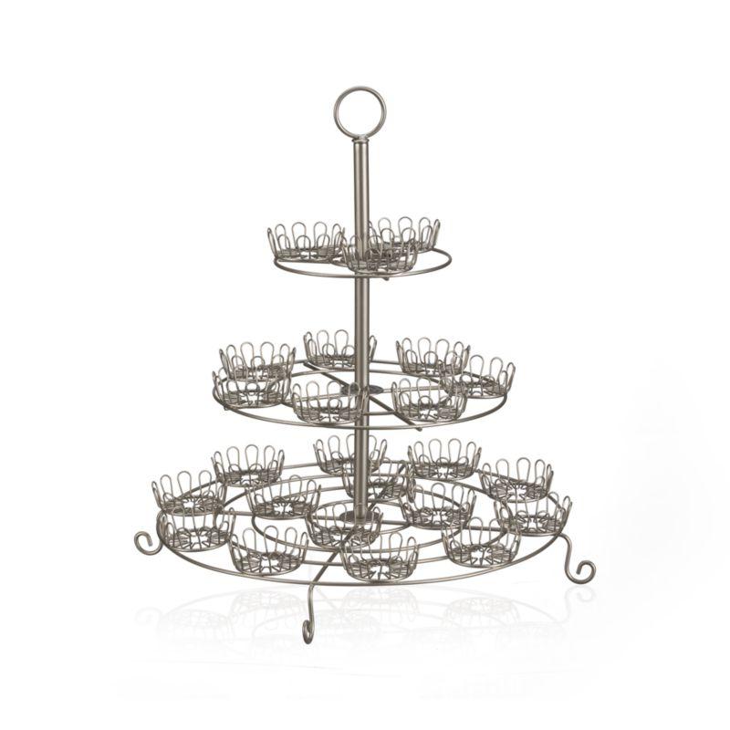 Flower-shaped holders ring classic steel wire stand with scroll feet and convenient loop handle. Holds two dozen cupcakes.<br /><br /><NEWTAG/><ul><li>Steel wire</li><li>Polished finish</li><li>Disassembles for easy storage</li><li>Clean with a dry or damp cloth</li><li>Made in Taiwan</li></ul>