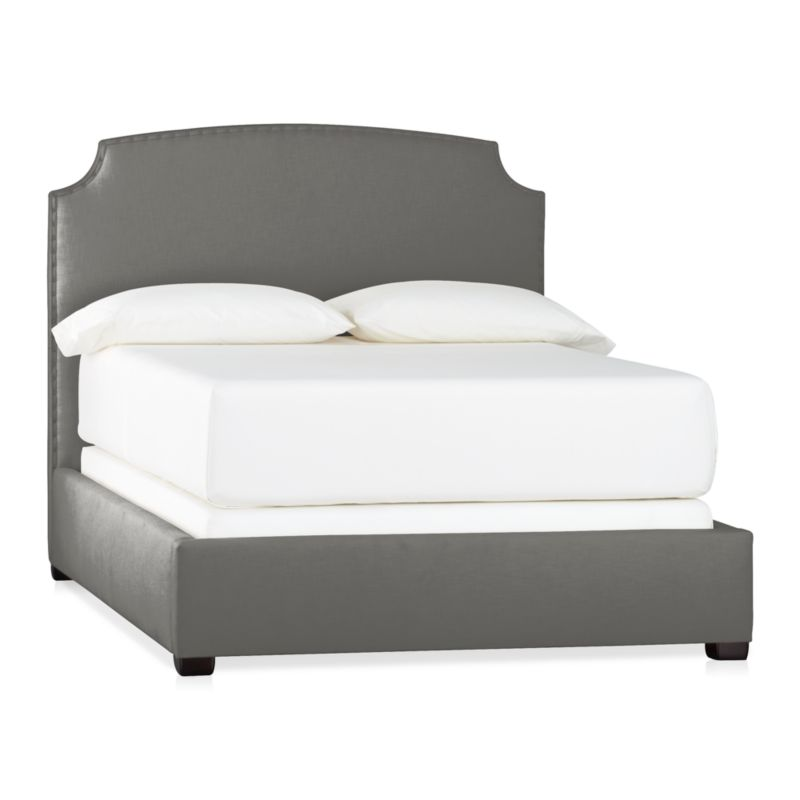 This alluring new shape stays ahead of the curve with clean contours and contemporary styling. Wrapped in a soft neutral cotton/poly blend fabric, graceful corner arcs carve an element of drama into the sleek profile. A delicate row of antiqued brass nailheads accentuate every curve, adding a subtle sweep of glamour. Mattresses and foundations available (sold separately).<br /><br />After you place your order, we will send a fabric swatch via next day air for your final approval. We will contact you to verify both your receipt and approval of the fabric swatch before finalizing your order.<br /><br /><NEWTAG/><ul><li>Certified sustainable kiln-dried hardwood frame</li><li>Soy-based foam cushioning</li><li>Cotton-poly blend fabric</li><li>Solid maple legs have an espresso finish</li><li>Slat system with support legs</li><li>Accommodates a mattress and foundation</li><li>Made in North Carolina, USA of domestic and imported materials</li></ul>