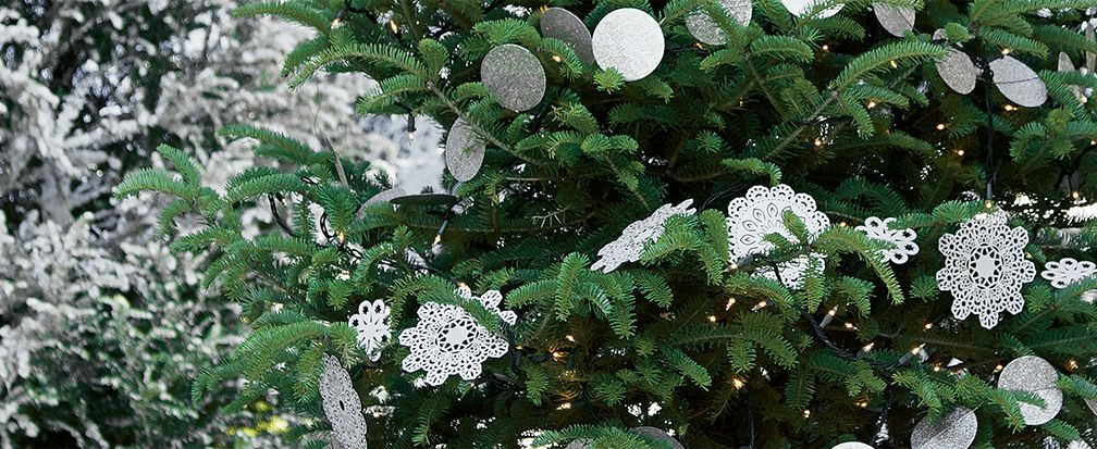 White Snowflake and Circle Garland on a Christmas Tree