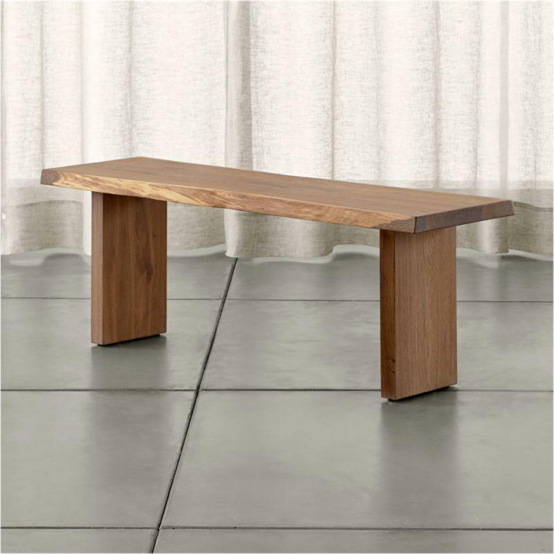 "Dakota's dramatic sweep of European white oak pales in modern shades of grey, setting an organic, elegantly understated tone for the dining room. Undulating curves sanded smooth follow the tree's unique profile, exposing natural wood tones. <NEWTAG/><ul><li>Solid European white oak with fumed finish</li><li>Plastic floor glides</li><li>Seats two</li><li>Sized for our Dakota 77"" Dining Table</li><li>Made in Poland</li></ul>"