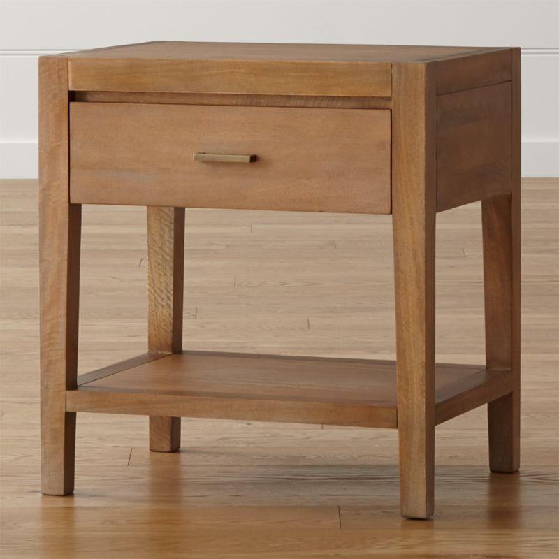 This handsome nightstand echoes the trim, tailored lines of our Dawson collection with its richly grained solid mango wood showcased in a serene, matte grey wash. Naturally occurring knots and grain and wire brushing add character to each nightstand, a convenient bedside companion with a fixed lower shelf and storage drawer with antique, cast brass pull. The Dawson Nightstand is a Crate and Barrel exclusive.<br /><br /><NEWTAG/><ul><li>Solid sustainable mango wood, mango veneer and engineered wood</li><li>Wire-brushed and grey-washed with toner</li><li>Naturally expands and contracts with seasonal changes in humidity</li><li>Self-closing undermount metal drawer glides</li><li>Cast brass drawer pull with antique finish</li><li>Made in Indonesia</li></ul>