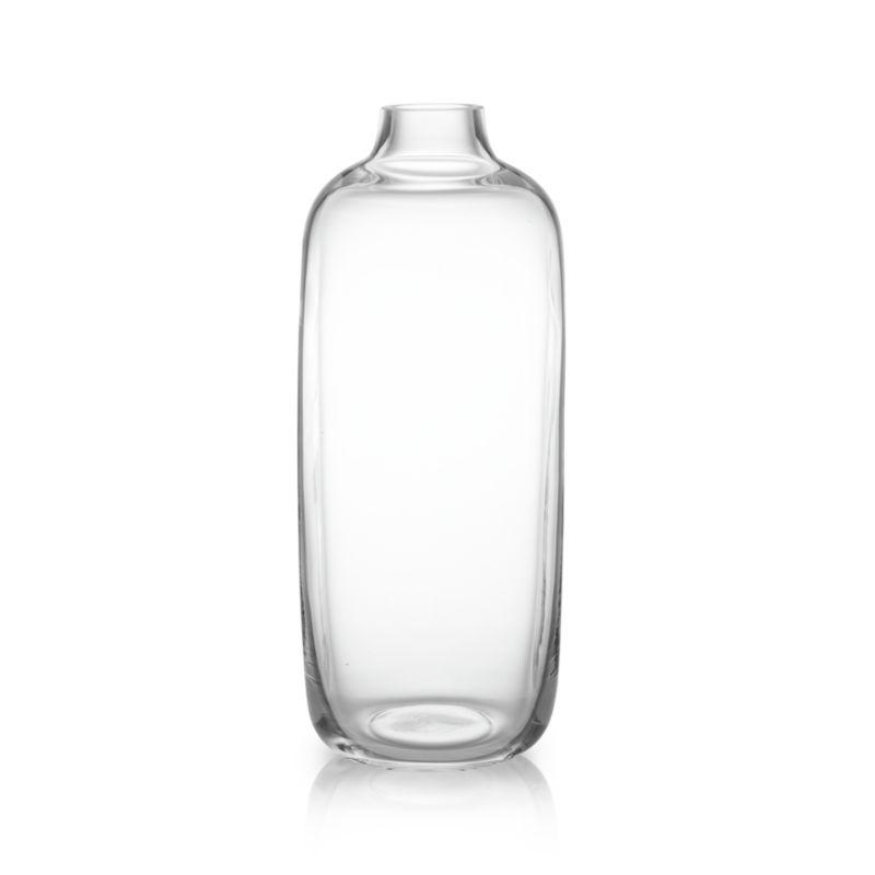 An organic cylindrical vessel is handcrafted by Eastern European glassblowers in clear glass with indented sides and freeform sham. Its tall silhouette and narrowed neck create drama around a single stem or botanical display.<br /><br /><NEWTAG/><ul><li>Handmade glass</li><li>Watertight</li><li>Hand wash</li><li>Made in Poland</li></ul>