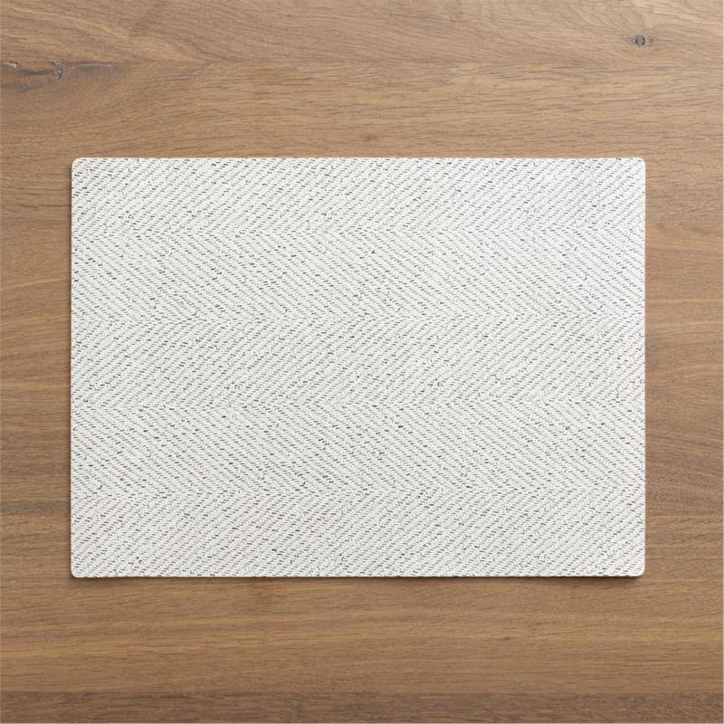 "Tweedy printed graphic ""weaves"" a muted black-and-white herringbone pattern on textured, easy-care vinyl.<br /><br /><NEWTAG/><ul><li>100% PVC</li><li>Stain resistant</li><li>Wipe with damp cloth</li></ul>"