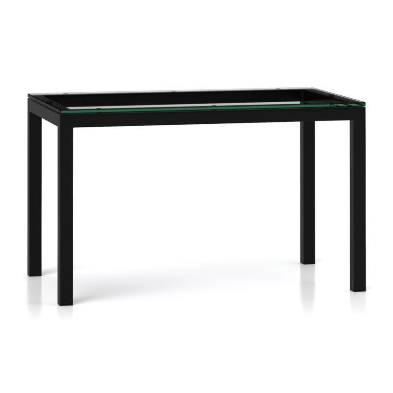 """You've designed your ideal table, from top to bottom in just the right size. Clear float glass makes a transparent top that's ⅝-inch thick with a flat, polished edge. The traditional Parsons-style base is a hot-rolled steel frame that supports with clean simple lines, hand-welded and ground at each corner with a raw, torched millscale finish. Perfect for kitchens and smaller spaces, this table seats up to 4. The Clear Glass Top/Parsons Dark Steel Base 48""""x28"""" Dining Table is a Crate and Barrel exclusive.<br /><br /><NEWTAG/><ul><li>⅝"""" glass top with flat polished edge</li><li>Non-tempered glass</li><li>Cut and welded natural dark tubular steel base with torched millscale finis"""