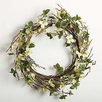 Dogwood's friendly white blooms pop with springtime freshness on a wreath of faux branches.
