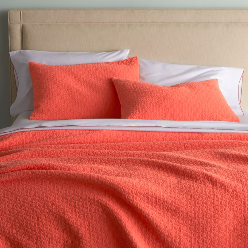 Jacquard-woven dots pepper classically elegant bed linens with subtle texture in a gorgeous shade of coral. Pairs beautifully with our Belo Coral sheet set.<br /><br /><NEWTAG/><ul><li>96% cotton and 4% polypropylene</li><li>Machine wash cold, tumble dry low; warm iron as needed</li><li>Made in Portugal</li></ul><br />