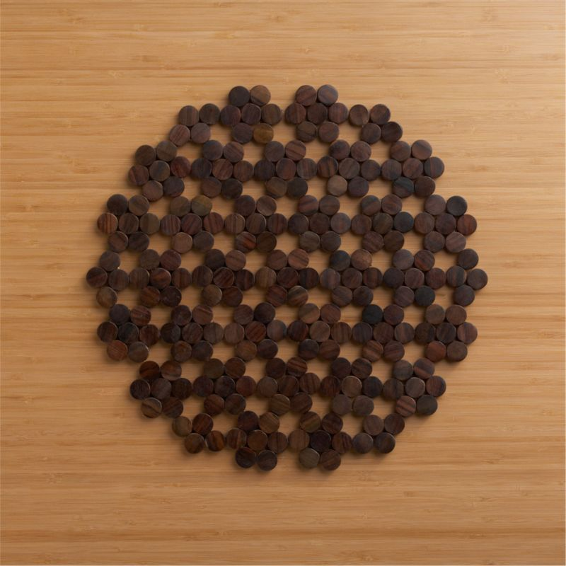 Clusters of wood chips form a wooden round that's like no doily you've ever seen.<br /><br /><NEWTAG/><ul><li>Sonokeling wood placemat</li><li>Clean placemat with a damp cloth</li></ul>