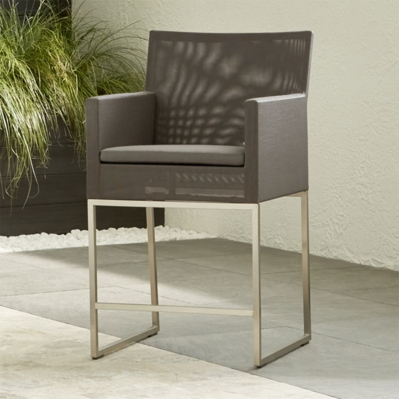 "With sleek outdoor-grade stainless steel frames covered in taupe synthetic mesh, our urban style Dune collection is truly a modern ""indoor room"" that lives outdoors. The counter stool is outfitted with a tonal taupe acrylic cushion  in weather-resistant Sunbrella. <NEWTAG/><ul><li>Outdoor-grade stainless steel frame upholstered in Batyline synthetic mesh</li><li>Fade- and mildew-resistant Sunbrella acrylic cushion</li><li>Foam padding</li><li>24""H seat sized for counters</li><li>Made in China</li></ul>"