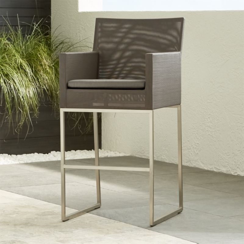 "This modern collection truly represents an ""indoor room"" that lives outdoors. Take a seat in urban style on our Dune Bar Stool, with a sleek outdoor-grade stainless steel frame covered in taupe Batyline ® synthetic mesh. <NEWTAG/><ul><li>Outdoor-grade stainless steel frame upholstered in Batyline ® synthetic mesh</li><li>Fade- and mildew-resistant Sunbrella acrylic cushion</li><li>Foam padding</li><li>30""H seat sized for bars</li><li>Made in China</li></ul>"