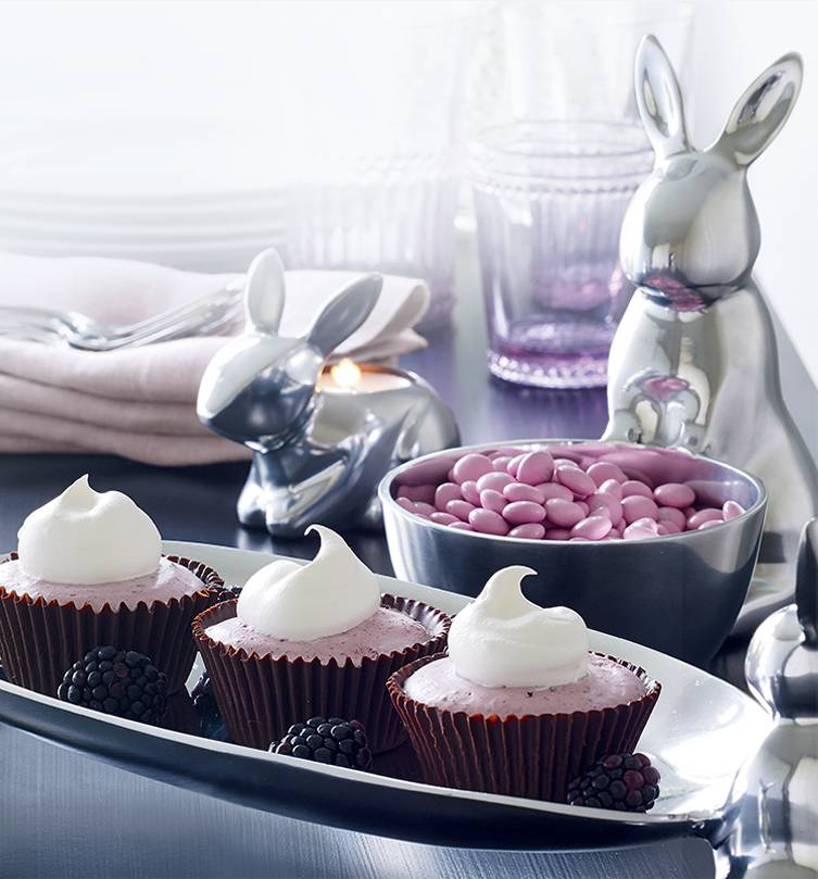 Easter table setting featuring silver bunnies, purple drinkware and purple candies