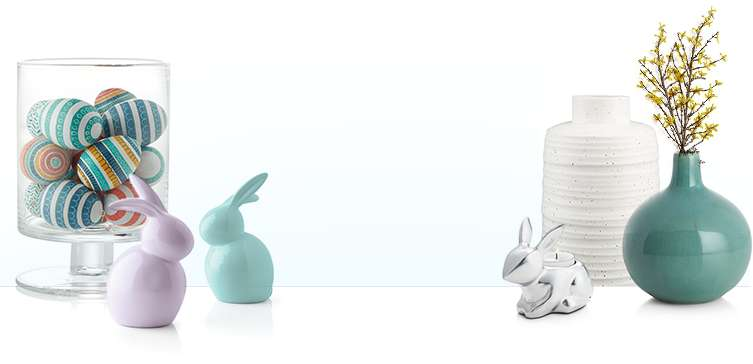 Decorated Easter eggs, lavendar and teal ceramic rabbits, white and teal vases and a silver bunny