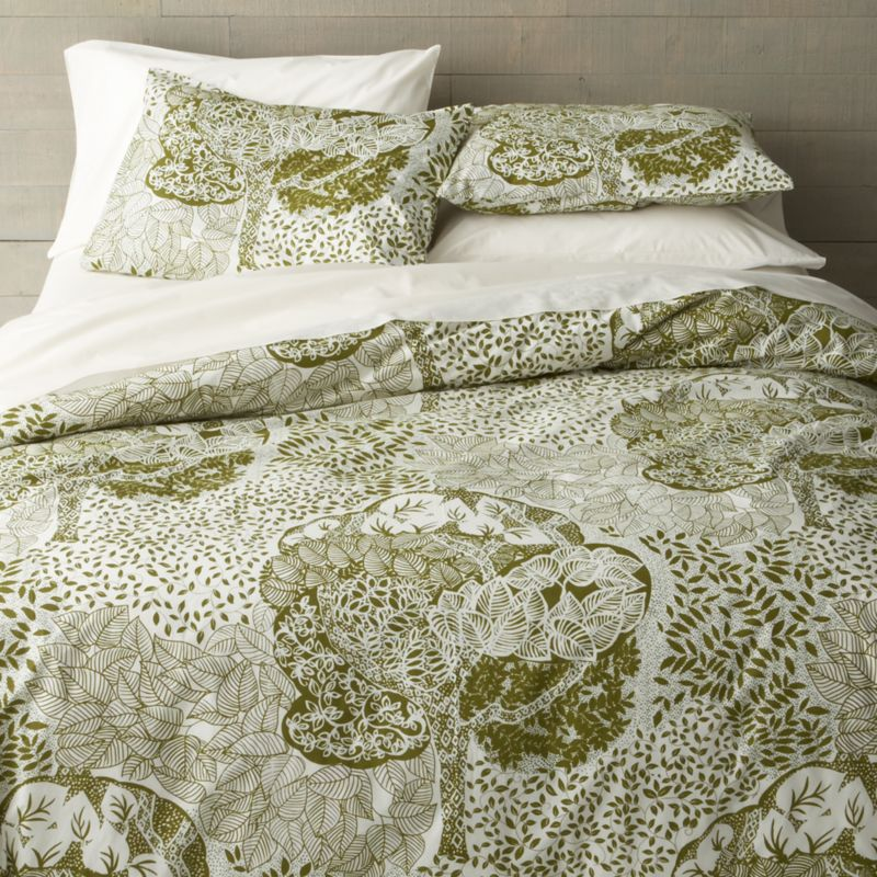 Relax into a fantasyland of lush trees, limbs and leaves, printed in soothing forest green on creamy cotton. Reversing to solid cream, the duvet cover is tailored with button closure and internal ties to stability the duvet. Duvet inserts also available.<br /><br /><NEWTAG/><ul><li>100% cotton</li><li>180-thread-count</li><li>Machine wash, tumble dry low, warm iron as needed</li><li>Made in India</li></ul>