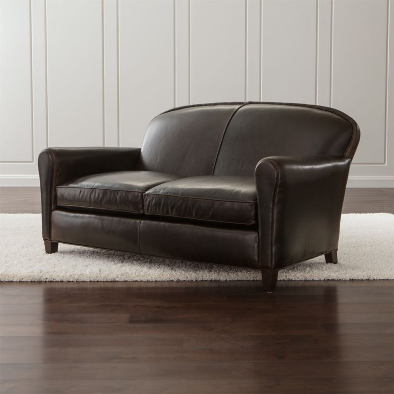 Our classic French Deco leather loveseat has all the authentic provenance of the originals, from its low seat to its angled back. Eiffel is the epitome of comfort with 2 seat cushions crafted with eight-way hand-tied springs that support your every move. <NEWTAG/><ul><li>Frame is benchmade with sourced hardwood that's kiln-dried to prevent warping</li><li>Soy-based polyfoam seat cushions wrapped in regenerated synthetic fiber and encased in downproof ticking</li><li>Soy-based polyfoam and synthetic fiber back cushion</li><li>Eight-way hand-tied spring suspension</li><li>Hardwood legs with a black walnut finish</li><li>Made in North Carolina, USA of domestic and imported materials</li></ul>