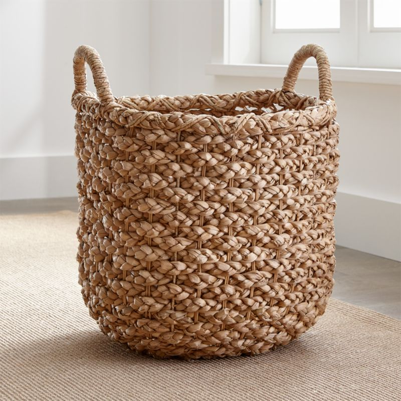 Chunky braids of rustic bankuan leaves weave a tall textural basket, ready to stow toys, towels, magazines and more. Sturdy handles are soft to the touch but strong enough for carting stored items. Casual storage option adds a warm natural touch to any room.<br /><br /><NEWTAG/><ul><li>Bankuan, rattan, wicker and wire</li><li>Indoor use only</li><li>Wipe clean with soft, dry cloth</li><li>Made in The Philippines</li></ul><br />