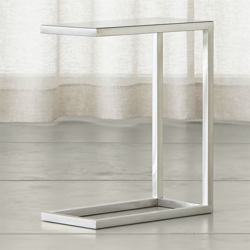 If ever there were a go-to accent table, this perpetually modern, stainless-steel design would be it. While Era's architectural lines are clean and simple, its tubular steel frame is hand-buffed to a gleaming finish by skilled craftsmen. <NEWTAG/><ul><li>Squared tubular stainless steel</li><li>Solid steel plate top</li><li>Made in China</li></ul>