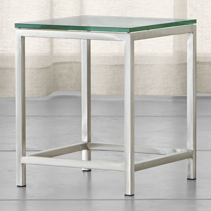 """If ever there were a go-to accent table, this perpetually modern, stainless-steel design would be it. While Era's architectural lines are clean and simple, its tubular steel frame is hand-buffed to a gleaming finish by skilled craftsmen. <NEWTAG/><ul><li>Squared tubular stainless</li><li>⅝""""-thick glass top with polished edges</li><li>Made in China</li></ul>"""