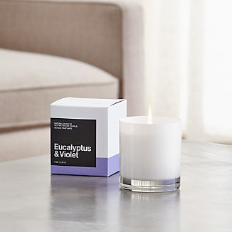 A flicker of fragrance to renew home and spirit. Our exclusive collection of handpoured, soy-blend candles brings together unique scent pairings to express your style and mood. Crisp, herbal eucalyptus and sweet, powdery violet mingle with essences of orange, camphor, clove, lily of the valley, wood, sandalwood, vanilla and musk.