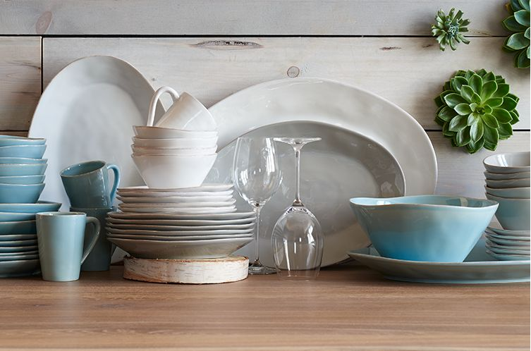 Stacked Marin Blue and White dinnerware and serving platters.