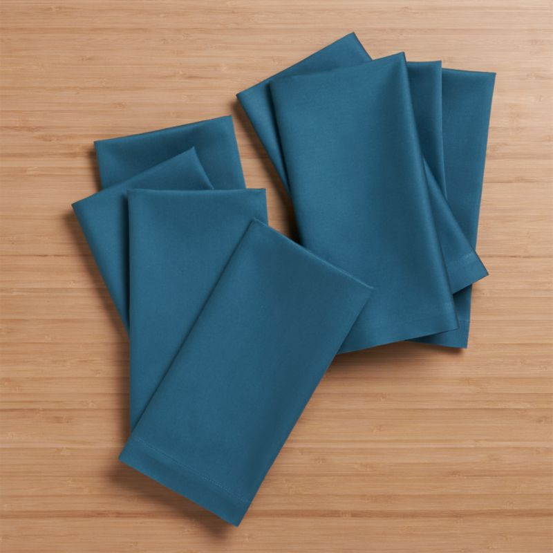 "Soft medium blue cloth napkins mix and match gorgeous tones of saturated color. Elegant yet easy-care napkin is tailor finished with 1"" hem and mitered corners.<br /><br /><NEWTAG/><ul><li>100% cotton</li><li>Machine wash cold, tumble dry; warm iron as needed</li><li>Made in India</li></ul>"
