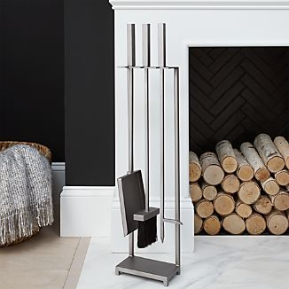 Clean, geometric lines lend a mid-century look to Ana Reza-Hadden's smart design for fireplace tools. Iron stand and tools—brush, shovel and poker--are handmade and given a warm, pewter finish.