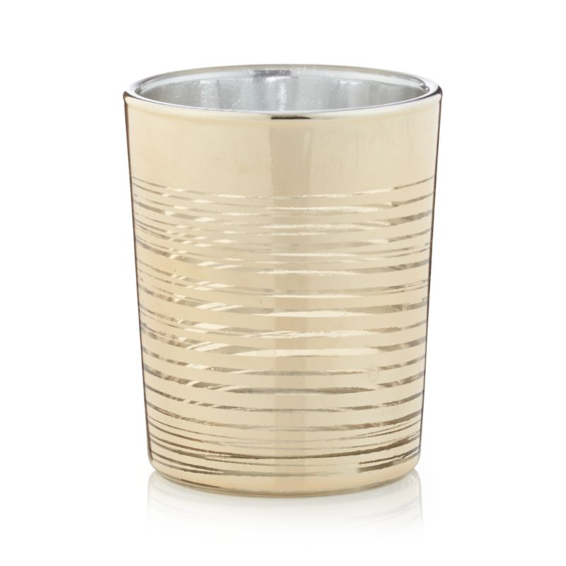 Luxe lighting at a great price. Clean-lined cylinders shine flickering candlelight through finely brushed rings of gold. A modern and elegant design with just the right amount of glitz.<br /><br /><NEWTAG/><ul><li>Glass with gold finish</li><li>Candleholder accommodates one tealight or standard votive candle, sold separately</li><li>Made in China</li></ul>