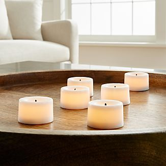 Candlelight without the flame. Flameless wax tealights glow with a realistic flicker.