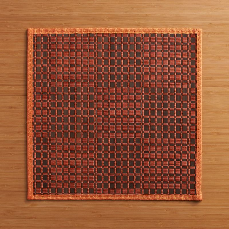 Two colors of thread bind bamboo slats together in a fun square pattern to complement the casual and formal table. Placemat rolls up for easy, space-saving transit to picnics and outdoor concerts, and for compact storage.<br /><br /><NEWTAG/><ul><li>100% bamboo with thread</li><li>Clean with damp cloth</li><li>Made in China</li></ul>