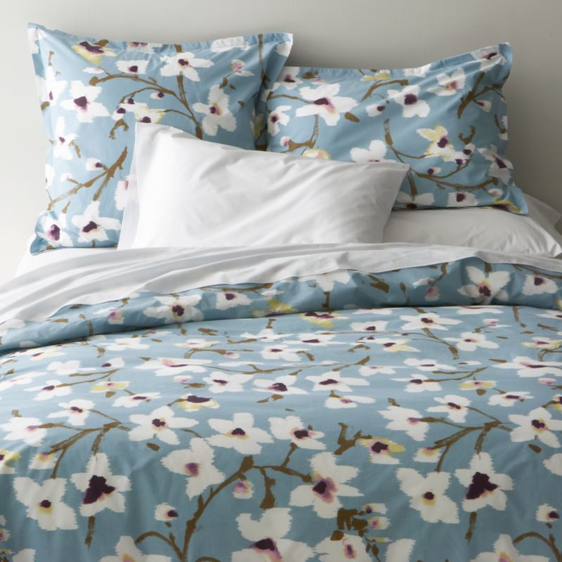Painterly magnolias blossom springtime blooms on soft blue, realized in super-soft cotton percale. Reversible duvet cover features a hidden button closure at the bottom and interior fabric ties to hold the insert in place. Duvet inserts also available.<br /><br /><NEWTAG/><ul><li>100% cotton percale</li><li>200-thread-count</li><li>Machine wash cold, tumble dry low</li><li>Made in Portugal</li></ul>