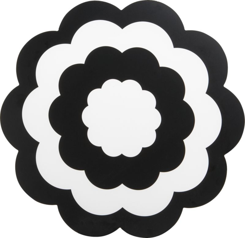 Place settings blossom on fresh floral-shape placemat. Graphic concentric flower pattern is screened in black on clear base of easy-care polypropylene. Wipes clean with damp cloth.<br /><br /><NEWTAG/><ul><li>Polypropylene</li><li>Wipe clean with damp cloth</li></ul>