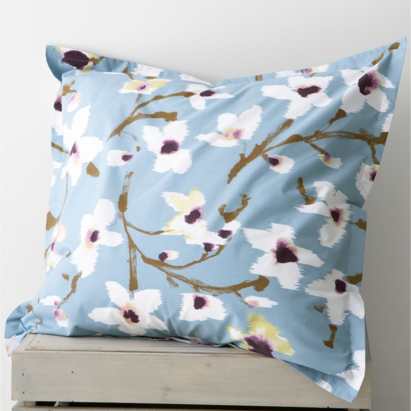 Painterly magnolias blossom springtime blooms on soft blue, realized in super-soft cotton percale. Reversible sham has generous overlapping back closure. Bed pillows also available.<br /><br /><NEWTAG/><ul><li>100% cotton percale</li><li>200-thread-count</li><li>Machine wash cold, tumble dry low</li><li>Made in Portugal</li></ul>