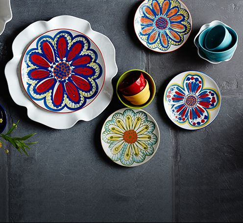 Colorful floral plates, bowls and serveware.