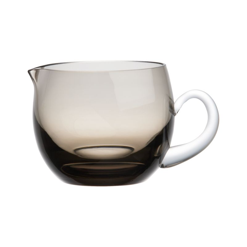 Creamer gets a glamorous makeover in a rich smoky hue, handcrafted of encased glass with a clean rounded profile and clear handle.<br /><br /><NEWTAG/><ul><li>Handcrafted</li><li>Encased glass</li><li>Hand wash</li><li>Made in China</li></ul>