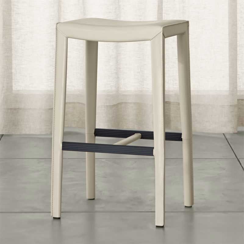 This open perch, sized especially for the bar, reinvents classic Italian design with clean Parsons-style lines and comfort and value in mind. This sleek, versatile bar stool is fully wrapped in durable bonded leather and finished with the kind of details that make it a customer favorite: neat mitered corners, flange seaming and stitching. <NEWTAG/><ul><li>Welded steel frame</li><li>Polyfoam seat cushion with fiber wrap</li><li>Mitered cut and stitched leather</li><li>Flange seaming</li><li>Grooved footrest</li><li>Made in China of domestic and imported materials</li></ul>
