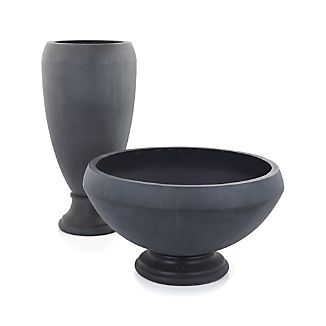 A sophisticated pedestal design with sculptural, deep-rimmed bowl and chic charcoal coloration lends visual impact to indoor-outdoor florals and greenery. The urn's wide opening allows for gorgeous multiple flowers to blossom or just a single dramatic plant.Fiberglass, cement, sandIndoor or outdoor useBring inside during freezing weather conditionsMade in Vietnam