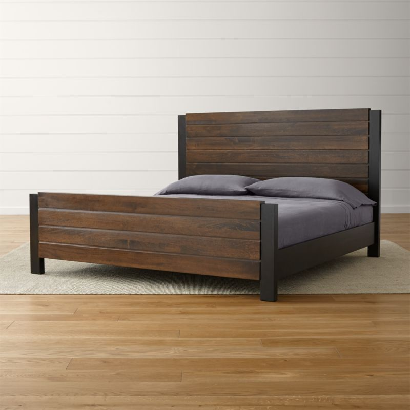 "Forsyth's clean, straightforward styling in natural mango wood brings a bold look to the bedroom in a striking two-tone mix. Deep espresso and warm tobacco enrich refined planks to bring out the wood's richly grained beauty. <NEWTAG/><ul><li>Designed by Blake Tovin of Tovin Design</li><li>Solid mango headboard and footboard with tobacco brown finish</li><li>Solid mango side rails with espresso finish</li><li>Tubular steel legs</li><li>2 sets of 15 slats and 1 center support leg</li><li>As with all solid woods, expansion and contraction may occur with seasonal changes in humidity</li><li>Platform bed designed for use with mattress only</li><li><a href=""/furniture/mattresses-foundations/1"">Mattresses</a> and optional <a href=/bunky-board/f30646>bunky board</a> available (sold separately)</li><li>Maximum weight capacity: 800 pounds (includes weight of mattress and occupants)</li><li>Made in India</li></ul>"