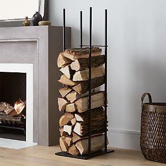 Tall, minimalist steel holder racks up a tower of neatly organized logs. Four dividers separate rowed-up logs into manageable stacks.
