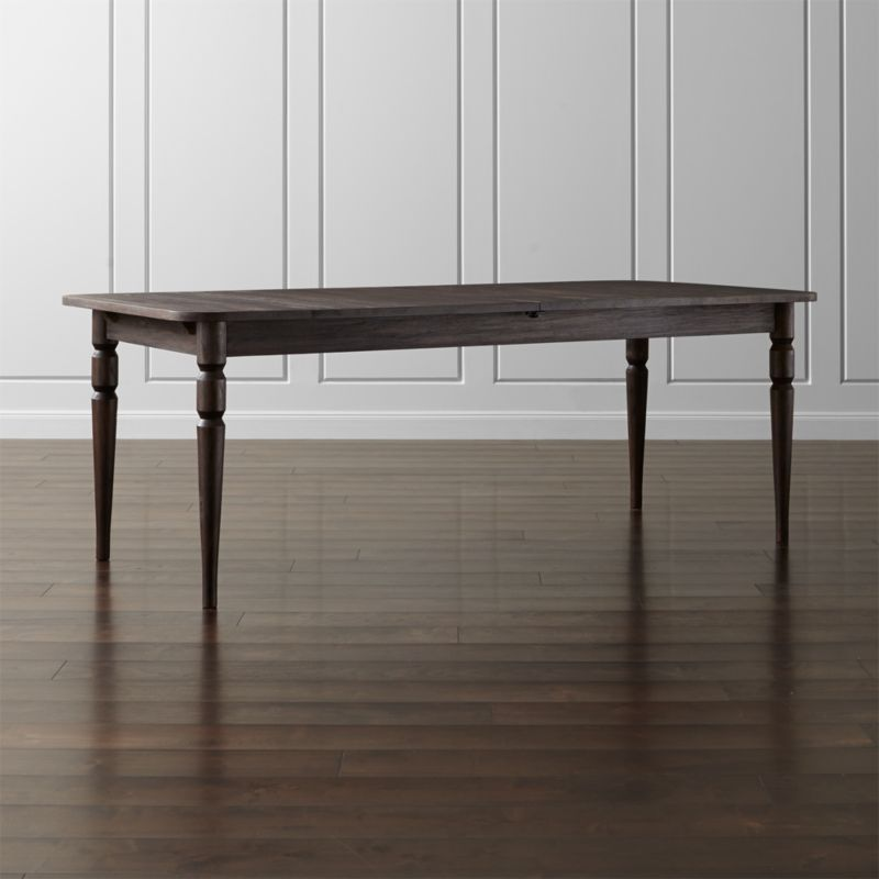 """Fremont nods to the classic farmhouse table's timeless style. Crafted from solid FSC-certified mahogany, the collection's wire-brushed finish and deep-brown stain reveal and accentuate the wood's natural grain. <NEWTAG/><ul><li>Designed by Russell Pinch</li><li>Solid FSC-certified mahogany</li><li>Wire-brushed with warm brown stain and clear matte topcoat</li><li>Finger-jointed, laminated teak wood glides</li><li>Levelers</li><li>Seats eight; 10 with 20"""" self-storing leaf</li><li>Made in Indonesia</li></ul><br />"""