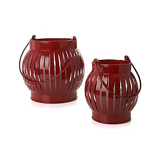 "Slatted lanterns have the look of paper luminaria with the sturdiness and industrial chic of galvanized iron. Lanterns are rust-resistant and look great on the table or hung on high from their long loop handles as 4th of July decorations.Beautiful shiny red ironSmall lantern accommodates a mini pillar candle (sold separately)Large lantern accommodates up to 3""-dia. pillar candle (sold separately)Wipe clean with damp clothMade in India"