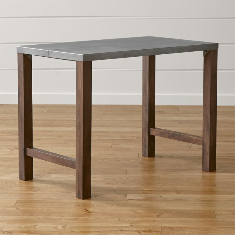 """An artisanal pairing of wood and metal, Galvin offers an industrial look that still reads warm and clean. A zinc-treated top—crafted from lengths of steel mimicking traditional wood planks—rests on solid mango legs with visible grain. <NEWTAG/><ul><li>Milled steel top hot-dipped in zinc with clear matte powdercoat finish</li><li>Solid mango wood legs with acrylic-based lacquer coat, hand finished with a rubbed wash wax finish</li><li>Naturally occurring grains and knots</li><li>Seats four</li><li>Accommodates 24"""" stools</li><li>Made in India</li></ul>"""