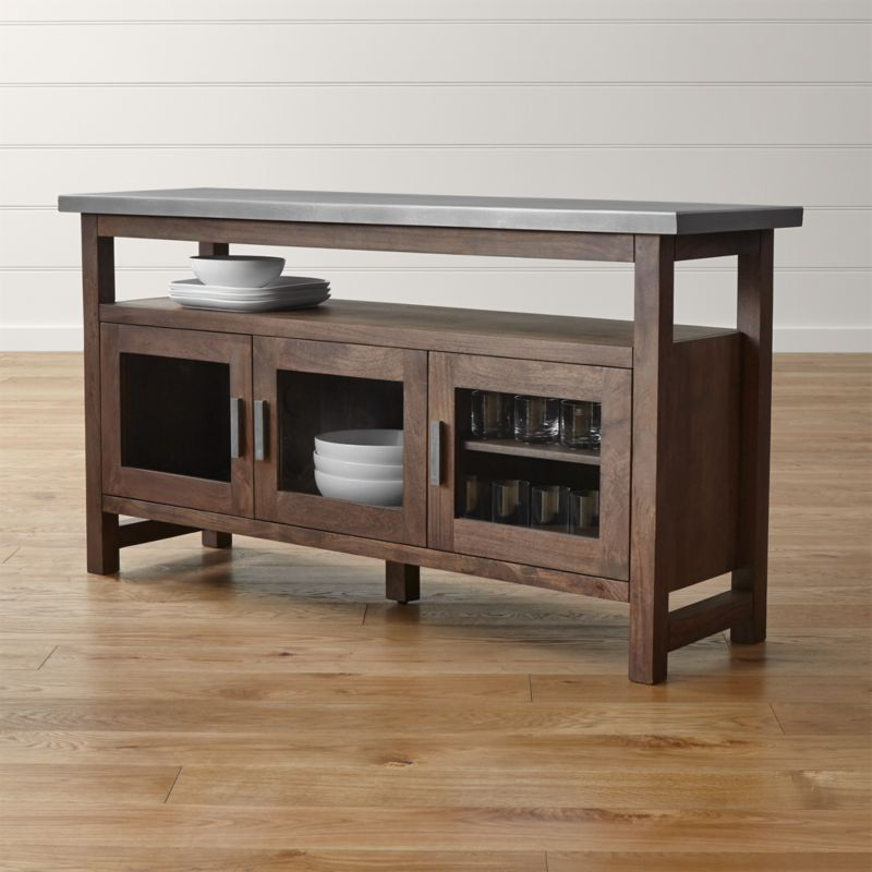 An artisanal pairing of wood and metal, Galvin offers an industrial look that still reads warm and clean. A zinc-treated top—crafted from lengths of steel mimicking a traditional wood plank—rests on solid mango base with visible grain. <NEWTAG/><ul><li>Milled steel top hot-dipped in zinc with clear matte powdercoat finish</li><li>Solid mango wood base with acrylic-based lacquer coat, hand finished with a rubbed wash wax finish</li><li>Naturally occurring grains and knots</li><li>Cast-iron pulls, glass panes and one adjustable shelf</li><li>Cord management cut-outs</li><li>Made in India</li></ul>