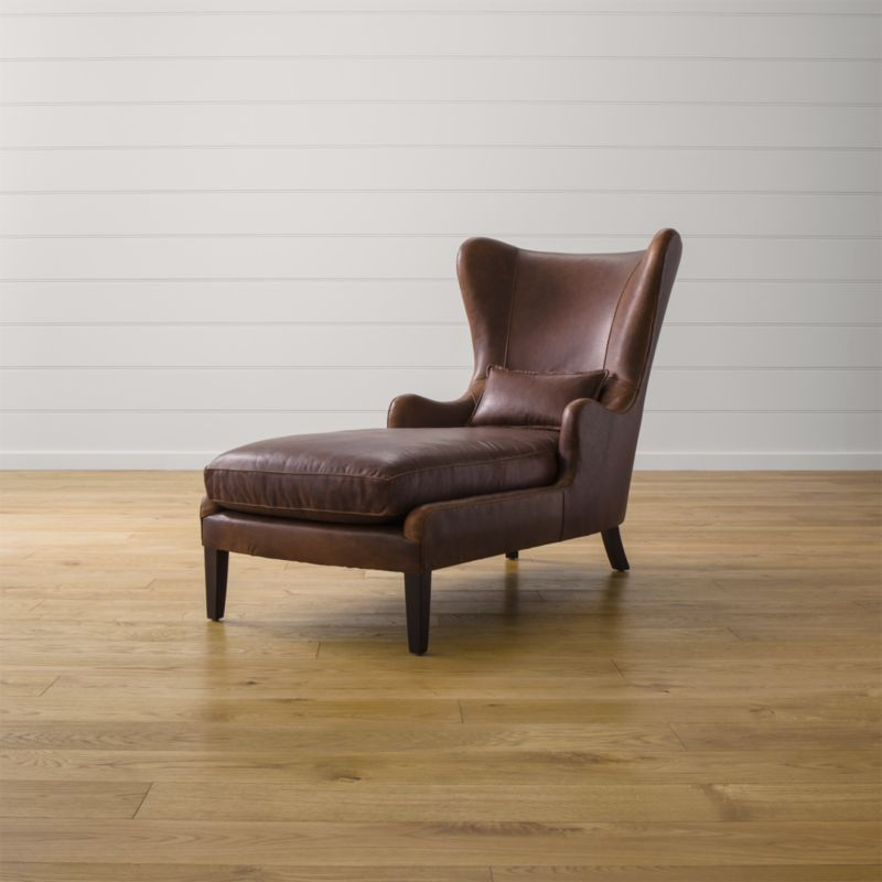 Sheltering in grand style, Garbo's traditional styling takes a fresh curve on tradition in fine top-grain leather. <NEWTAG/><ul><li>Frame is benchmade with eco-friendly, certified sustainable hardwood that's kiln-dried to prevent warping</li><li>Synthetic webbing suspension</li><li>Soy-based polyfoam seat cushion wrapped in synthetic fiber and encased in downproof ticking</li><li>Soy-based polyfoam and synthetic fiber tight back</li><li>Hardwood legs stained with black walnut finish</li><li>Made in North Carolina, USA of domestic and imported materials</li></ul>